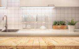 Wood table top on blur kitchen counter roombackground