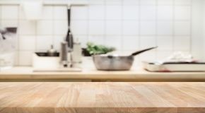 Wood table top on blur kitchen room background. For montage product display or design key visual layout royalty free stock photos