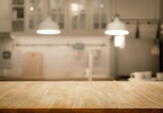Wood table top on blur kitchen room background stock images