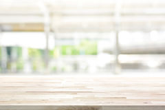 Wood table top on blur kitchen window background stock photo