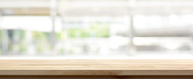 Wood table top on blur kitchen window background. Panoramic banner - can be used for display or montage your products or foods Royalty Free Stock Photo