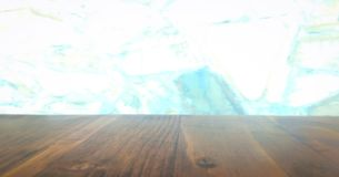 Wood table top on blur kitchen window background. for product or foods montage stock photos