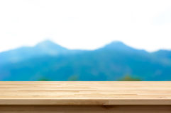 Wood table top on blur mountain background Royalty Free Stock Photos