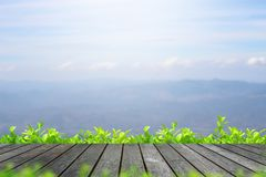 Wood table top on blur mountain view and sky background stock photography