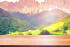 Wood table top on blur mountains background. Nature concepts. For montage product display Stock Image