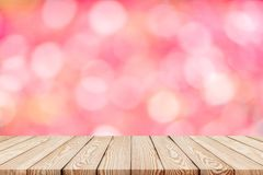 Wood table top on blur pink background of flower in the park. Can be used for display or montage your products stock photo