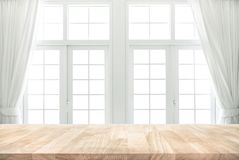 Wood table top on blur of white window with curtain background. In morning. For montage product display or design key visual layout stock images