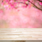 Wood table top on blurred background of pink cherry blossom flowers Royalty Free Stock Photos