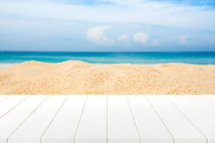 Wood table top on blurred beach. Background Stock Photos