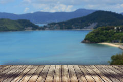 Wood table top on blurred blue sea background Stock Photos