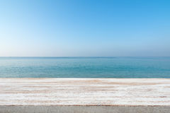 Wood table top on blurred blue sea and white sand beach backgrou Royalty Free Stock Photos