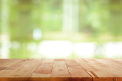 Wood table top on blurred green background Stock Photos