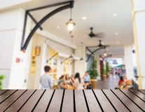 Wood table top on blurred restaurant beautiful decoration Royalty Free Stock Images