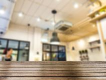 Wood table top on blurred restaurant beautiful Stock Image