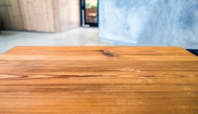 Wood table top on blurred room. Wood table top on blurred mortar room Royalty Free Stock Photo