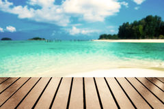 Wood table top on blurred sea beach white sand on sea Royalty Free Stock Photography