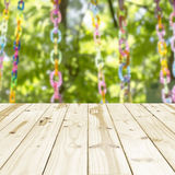 Wood table top on Blurry colured bead in green nature background. Stock Photography