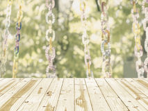 Wood table top on Blurry colured bead in green nature background. Stock Photo