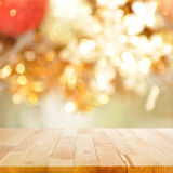 Wood table top on blurry gold background - festive background Royalty Free Stock Photos