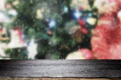 Wood table top on bokeh Christmas background. Royalty Free Stock Photo