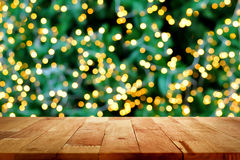 Wood table top with bokeh from decorative light on christmas tre. E in background Stock Photos