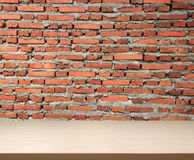 Wood Table Top And Brickwall Background Royalty Free Stock Photos