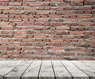 Wood Table Top And Brickwall Background Stock Photography