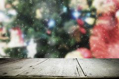 Wood table top on bokeh Christmas background. Royalty Free Stock Photos