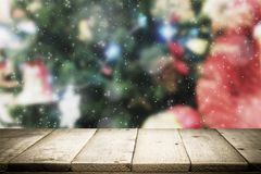 Wood table top on bokeh Christmas background. Stock Images