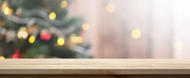 Wood table top on colorful bokeh background from decorated Chrismas tree. Wood table top on colorful bokeh background from decorated Christmas tree, panoramic Royalty Free Stock Photos