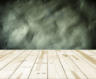 Wood table top on dark concrete walls backgrounds. Royalty Free Stock Photo