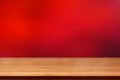 Wood table top on dark red abstract background Royalty Free Stock Photo