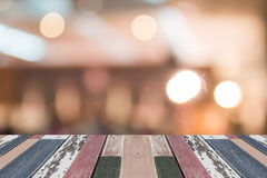 Wood table top on golden bokeh abstract background Stock Image