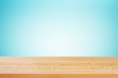 Wood table top on gradient blue background Royalty Free Stock Photo