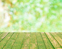 Wood table top on green bokeh blurred background stock images