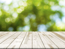Wood table top on Green nature bokeh blurred in background royalty free stock photography