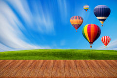 Wood table top on hot air balloons background Stock Photo
