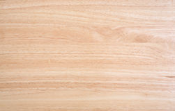 Wood table top. A laminated wood table top illuminated by natural light stock photos