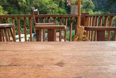 Wood table top on living room outdoors Royalty Free Stock Images