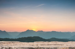 Wood table top on Majestic sunset in the mountains landscape Stock Photography