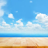 Wood Table Top On Blue Sea Water And Bright Summer Sky Background Stock Photos