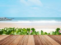 Wood table top over summer beach and blue sky royalty free stock photography