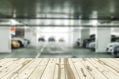 Wood table top on Parking lot blurred backgrounds. Stock Images