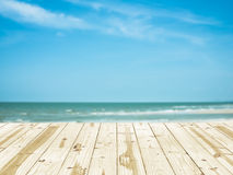 Wood table top on sea beach blurry backgrounds. Stock Images