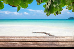 Wood table top on sea beach colorful white sand. Background Stock Photos