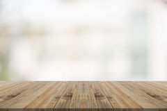 Wood table top on white blurred background from building. For montage your products Stock Images