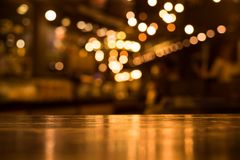 Free Wood Table Top With Reflect On Blur Of Lighting In Cafe,restaurant Royalty Free Stock Photography - 99764587