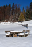 Wood table under snow. Space for dinner in a park was recored by snow Royalty Free Stock Image