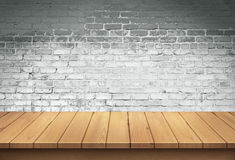 Wood table with White brick wall background. For display royalty free stock photography
