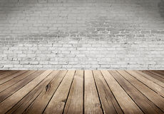 Wood table with White brick wall background. For display Stock Image